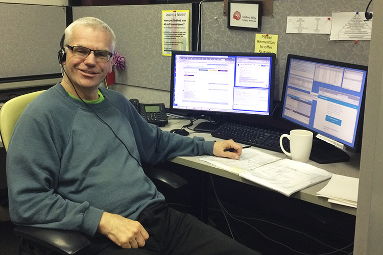 Peter Oxland at his work station at Distress Centre Calgary