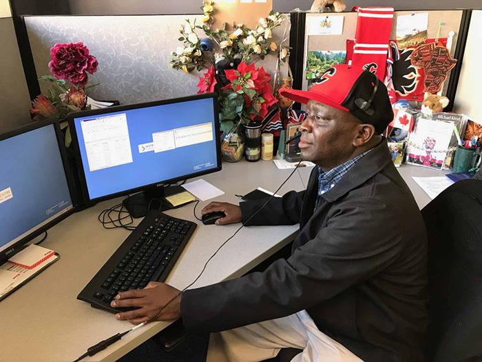 Michael at his desk at Distress Centre