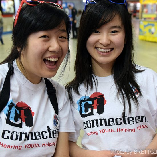 img des: Two people wearing shirts with the ConnecTeen logo.
