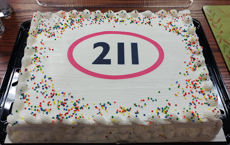 img des: Cake with the 211 logo on it.