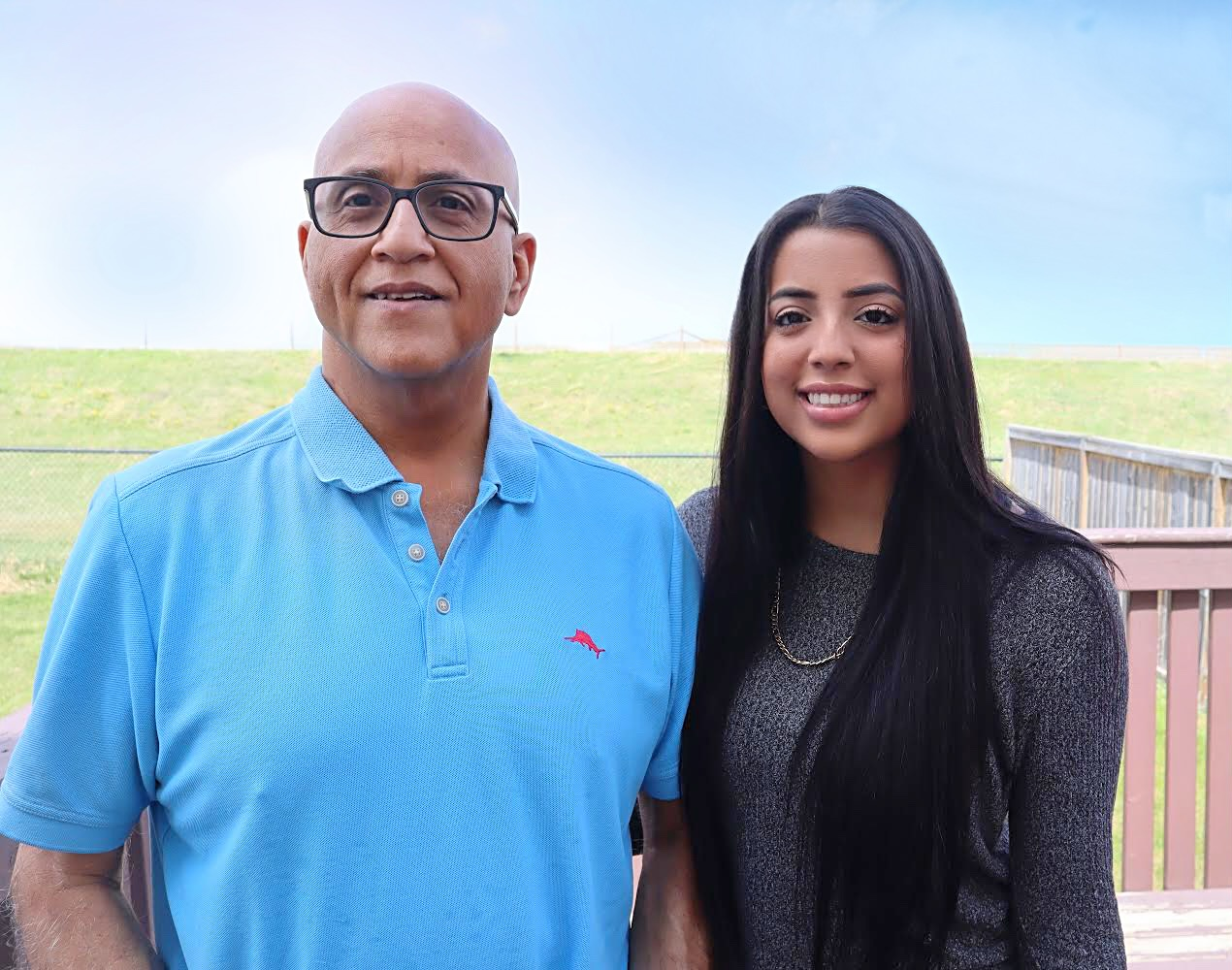 img des: Shamir and his daughter Ambreena standing together outside.
