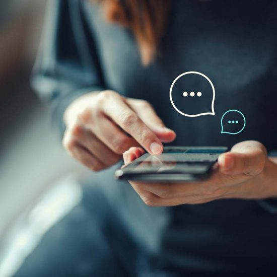img des: Person texting on a phone with speech bubble graphics